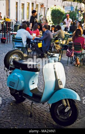 A Vespa in front of a cafe, Turin, Italy - Stock Photo