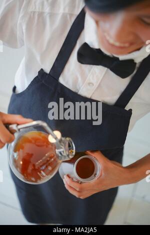 Filter coffee being made, a barista with a syphon at the 'Stockholm Espresso Club' in Hamburg - Stock Photo