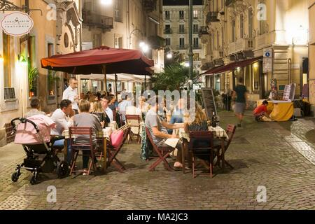 People in the street cafe 'Casa Martin' in Sant Agostino street, Turin, Italy - Stock Photo