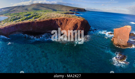 """An aerial view of Puu Pehe Rock at sunset, also known as """"Sweetheart Rock"""", one of Lanai's most recognizable landmarks, Lanai Island, Hawaii, USA. - Stock Photo"""