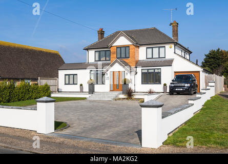 Large modern new detached house in a town in West Sussex, England, UK. - Stock Photo