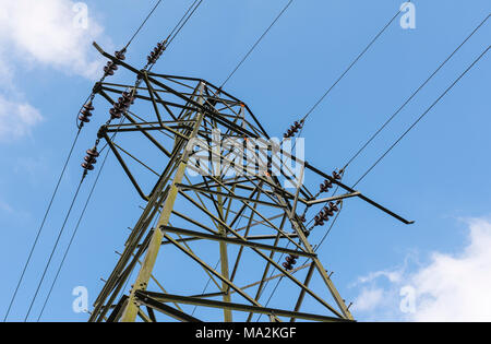 Electricity pylon and wires carrying electrical power on the National Grid in the UK. - Stock Photo