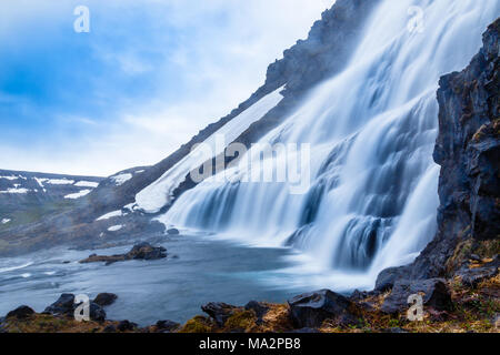 Dynjandi foss cascade waterfall with mossy canyon in the foreground, West Iceland - Stock Photo