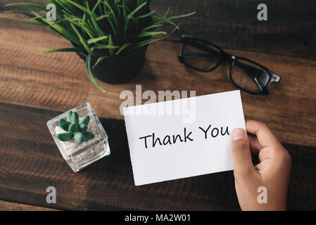 a boy with a paper note in his hands with the words THANK YOU. Appreciation concept - Stock Photo