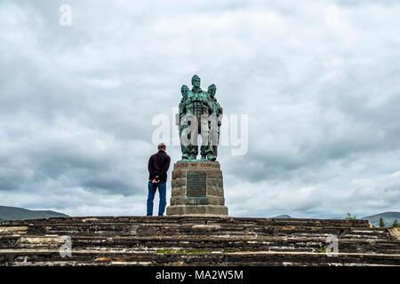 SPEAN BRIDGE / SCOTLAND - MAY 31 2017:: Man having a look at the Commando Memorial - Stock Photo