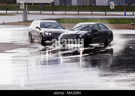Mercedes C63 AMG on the skid pan at Mercedes-Benz World, Brooklands in Weybridge, England. - Stock Photo