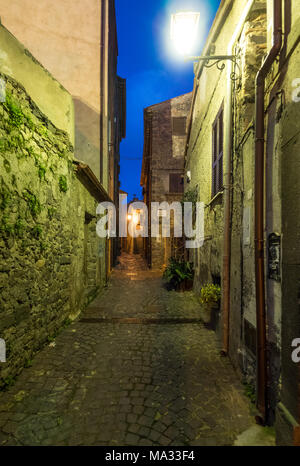 Bracciano (Italy) - The medieval historic center of the town in province of Rome famous for his castle and the lake. Here in the blue hour. - Stock Photo