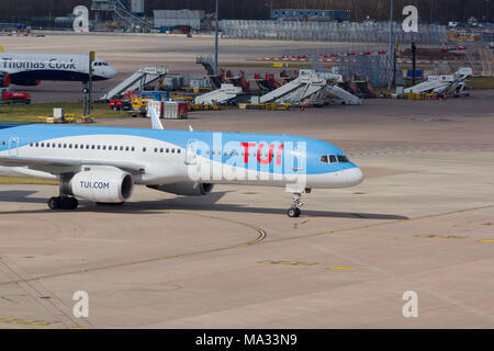 Boeing 757 200 airliner in the colours of TUI Group at Manchester airport - Stock Photo