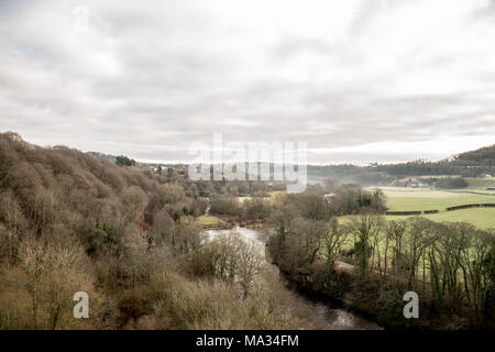 Beautiful Berwyn mountain landscapes of many trees lining the River Dee in the Welsh countryside in Llangollen, Denbighshire - Stock Photo