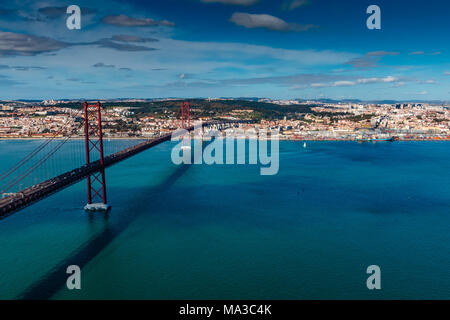 The 25 April bridge (Ponte 25 de Abril) is a steel suspension bridge located in Lisbon, Portugal, crossing the Targus river. It is one of the most fam - Stock Photo