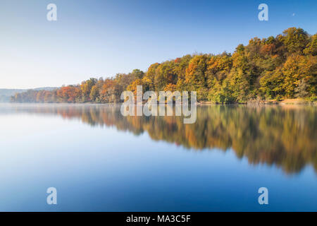 Foggy autumnal morning on the shores of river Ticino, Sesto Calende, Lake Maggiore, Varese Province, Lombardy, Italy. - Stock Photo