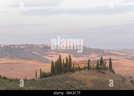 San Quirico d'Orcia, Province of Siena, Orcia Valley, Tuscany, Italy, Europe. View of Podere Belvedere at sunset with Pienza on the background - Stock Photo