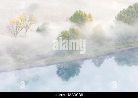 Mist over Adda river seen from Airuno at the Santuario Madonna della Rocchetta, Airuno, Parco dell'Adda Nord, Lecco province, Brianza, Lombardy, Italy. - Stock Photo