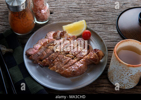 Pork grill or Buta Yaki in Japanese  Pork cooking style slice cut to serve. - Stock Photo