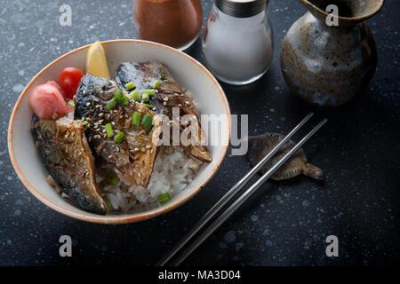 Saba mackerel fish grill with teriyaki sauce on rice in Japanese style. - Stock Photo