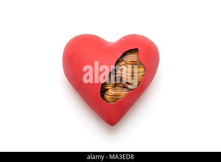 Red heart with golden coins over white background with clipping path - Stock Photo