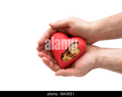 Red heart with golden coins in hands over white background with clipping path - Stock Photo