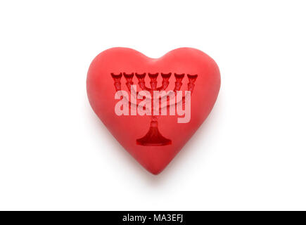 Red heart with imprinted menorah over white background with clipping path - Stock Photo