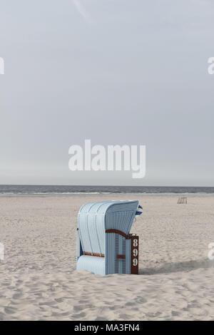 Light blue beach chairs on the island of Juist - Stock Photo