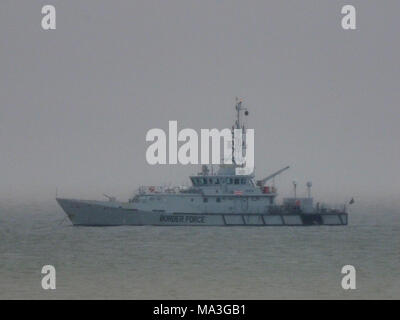 Sheerness, Kent, UK. 29th March, 2018. UK Weather: UK Border Force vessel HMC Seeker anchored off Sheerness in heavy rain. HMC Seeker is a Border Agency (customs) cutter. She was launched by Damen Shipyards in the Netherlands in 2001 and is one of four 42-metre (138 ft) cutters operated by the UK Border Agency. Credit: James Bell/Alamy Live News - Stock Photo