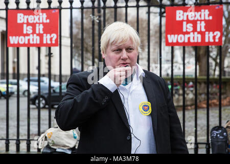 London, UK. 29th March, 2018. Boris Johnson lookalike Drew Galdron protests with pro-EU activists opposite Downing Street to mark the first anniversary of the triggering of Article 50 and a year before the UK's exit from the European Union, or Brexit, is scheduled to take place. Protesters dressed as 'EU super heroes' and 'Brexit villains'. Credit: Mark Kerrison/Alamy Live News - Stock Photo