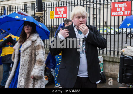 London, UK. 29th March, 2018. Pro-EU activists including Boris Johnson lookalike Drew Galdron protest opposite Downing Street to mark the first anniversary of the triggering of Article 50 and a year before the UK's exit from the European Union, or Brexit, is scheduled to take place. Protesters dressed as 'EU super heroes' and 'Brexit villains'. Credit: Mark Kerrison/Alamy Live News - Stock Photo