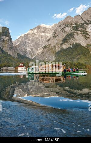 Ceremonial driving down of cattle from the mountain pastures into the valley in autumn over Königssee, Bavaria, Germany - Stock Photo
