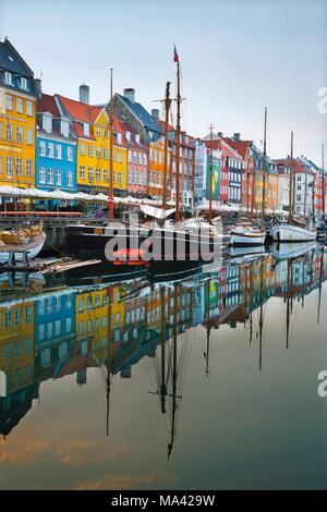 A row of colourful houses along the Nyhavn waterfront in Copenhagen, Denmark - Stock Photo