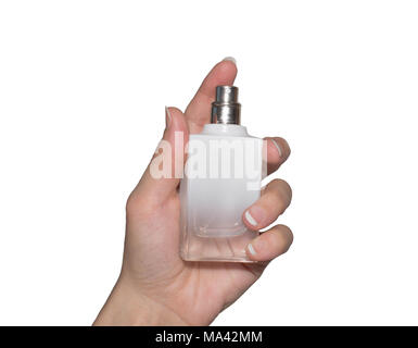 bottle of perfume in female hand on white isolated background - Stock Photo