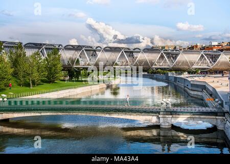 The Pasarela de la Arganzuela bridge and the Madrid Rio park in Madrid, Spain - Stock Photo