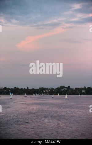 View of the Outer Alster with sailing boats in Hamburg, Germany - Stock Photo