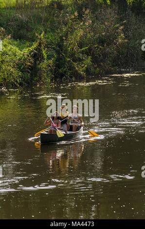 A family in a canoe on the Werra River in Thuringia, Germany - Stock Photo