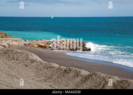 The town and the beach of Finale Ligure near Savona - Stock Photo