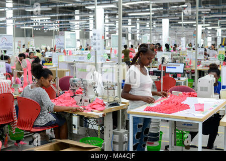 ETHIOPIA , Southern Nations, Hawassa or Awasa, Hawassa Industrial Park, chinese-built for the ethiopian government to attract foreign investors with low rent and tax free to establish a textile industry and create thousands of new jobs, textile company Hela Indochine Apparel PLC a joint venture of sri lankan and chinese companies / AETHIOPIEN, Hawassa, Industriepark, gebaut durch chinesische Firmen fuer die ethiopische Regierung um die Hallen fuer Textilbetriebe von Investoren zu vermieten, Textilfabrik Hela Indochine Apparel PLC - Stock Photo