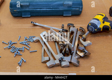fittings for furniture. Handles for cabinets on a handles for kitchen cabinets - Stock Photo