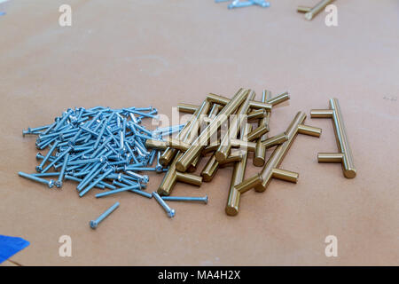 handles for kitchen cabinets accessories for kitchen furniture. pens - Stock Photo