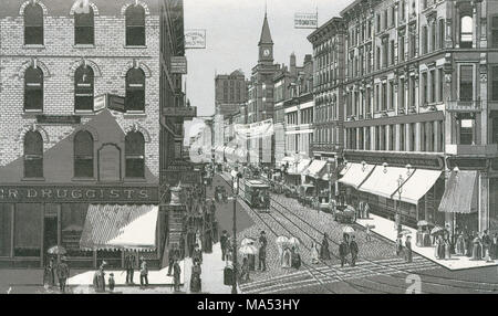 Antique c1885 monochromatic print from a souvenir album, showing West Madison Street from State Street in Chicago, Illinois. Printed with the Glaser/Frey lithographic process, a multi-stone lithographic process developed in Germany. - Stock Photo