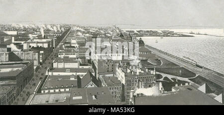 Antique c1885 monochromatic print from a souvenir album, showing a bird's eye view of Chicago, Illinois on Monroe Harbor. Lake Michigan at right; the large street is Michigan Avenue; the railroad is the Illinois Central and Michigan Central Railroad; the large domed building at right is the Interstate Industrial Exposition Building. Breakwater and New East Side visible in background at right. Printed with the Glaser/Frey lithographic process, a multi-stone lithographic process developed in Germany. - Stock Photo