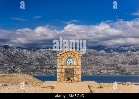 Croatia, Dalmatia, island of Pag, Miskovici, altar of Mary at the southern tip towards Velebit mountains - Stock Photo