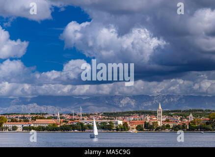 Croatia, Dalmatia, Zadar, old town towards Velebit mountainss, view from the ferry - Stock Photo