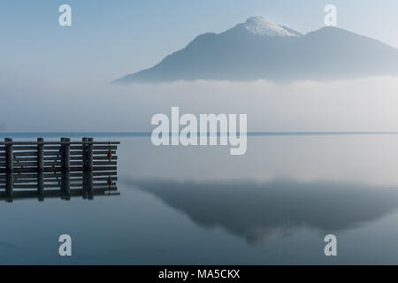 View over the Lake Walchen / Walchensee with the Jochberg in the background, early in the morning - Stock Photo