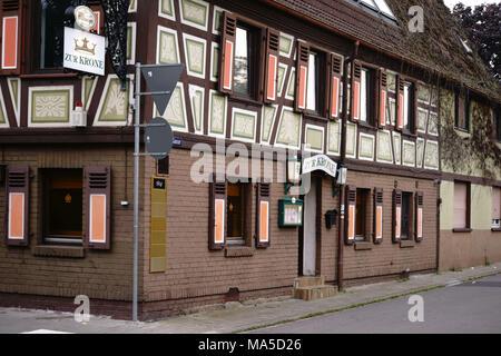 Corner entrance of the old listed restaurant 'Zur Krone' in Bischofsheim, - Stock Photo
