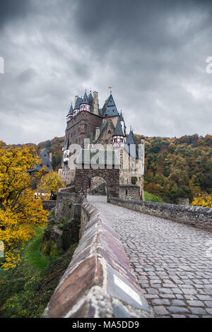 The autumnal castle Eltz in cloudy sky. - Stock Photo
