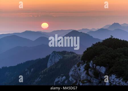 Germany, Bavaria, Bavarian foothills, Lenggries, Spectacular sunrise on the Benediktenwand (mountain) - Stock Photo