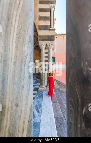 Amalfi, Amalfi Coast, Salerno Province, Campania, Italy, Girl walks for the Amalfi Cathedral - Stock Photo