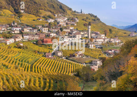the village of Santo Stefano surrounded by the yellow vineyards in autumn, along the road of wine, Valdobbiadene, Treviso, Veneto, Italy - Stock Photo