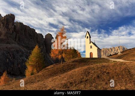 Cappella di San Maurizio at Passo Gardena / Grödner Joch in autumn, Selva di Val Gardena, Corvara in Val Badia, Province of Bolzano, Trentino Alto-Adige, Italy - Stock Photo