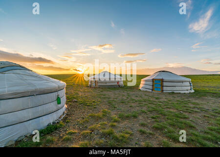 Mongolian nomadic traditional gers while the sun sets. Middle Gobi province, Mongolia. - Stock Photo