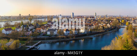 Beautiful overlook on the cityscape of Kehl on evening with the Rhine river on the left, border between Germany and France, from the Weißtannenturm. - Stock Photo