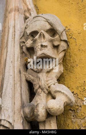 Stone skull on a Trinity Church's cemetery grave markers, Church of the Holy Trinity,Unesco world heritage sight, Regensburg, Bavaria, Germany - Stock Photo
